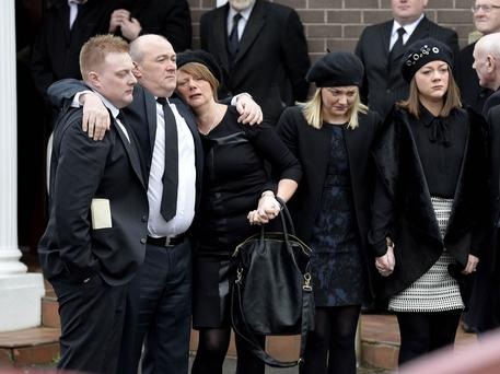 The funeral of Karla Cameron who tragically lost her life in a road traffic collision on the A26 Ballymena has taken place at her church Ballee Baptist in Ballymena. Karla's husband David is comforted by friends as Karla's coffin is carried from the church.