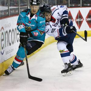 Belfast Giants' Chris Higgins with Dundee Stars' Riley Wetmore during Tuesday nights Elite League game at the SSE Arena, Belfast. Photo by William Cherry / Presseye