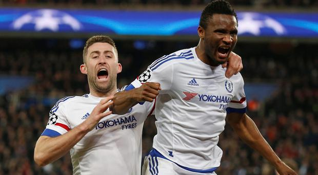 Chelsea's John Obi Mikel, right, celebrates with teammate Chelsea's Gary Cahill after scoring his side first goal during the Champions League round of 16, first leg, soccer match between Paris Saint Germain and Chelsea at the Parc des Princes stadium, in Paris, Tuesday, Feb. 16, 2016. (AP Photo/Francois Mori)