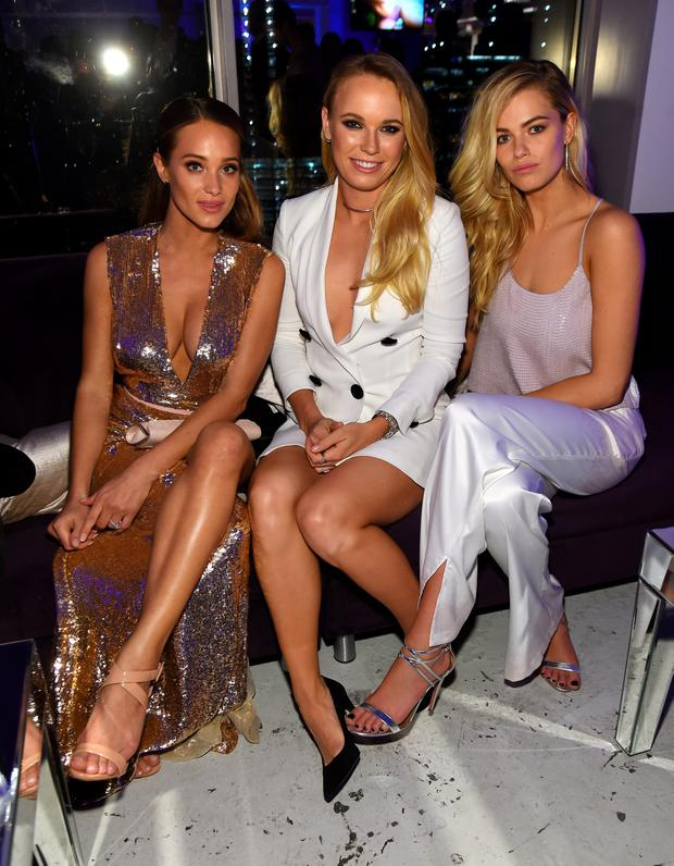 Caroline Wozniacki (C) poses with models Hannah Davis and Hailey Clauson at the Sports Illustrated Swimsuit 2016 - NYC VIP press event on February 16, 2016 in New York City. (Photo by Jamie McCarthy/Getty Images for Sports Illustrated)