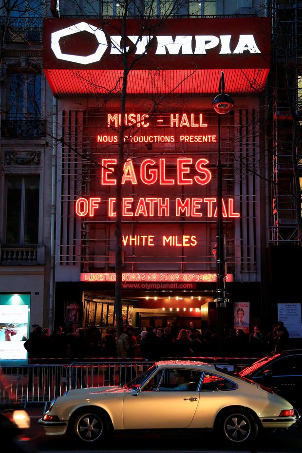 A crowd waits outside the Olympia music hall the Eagles of Death Metal's concert, in Paris, Tuesday, Feb. 16, 2016. (AP Photo/Thibault Camus)