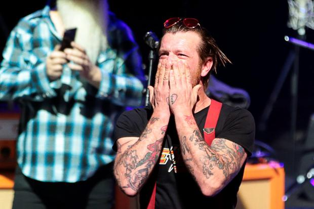 Eagles of Death Metal frontman Jesse Hughes blows a kiss before the start of the concert at the Olympia concert hall in Paris, on February 16, 2016. Pic JOEL SAGET/AFP/Getty Images