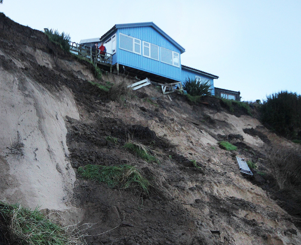 The house on the Wexford coastline hangs over the edge of the cliff.