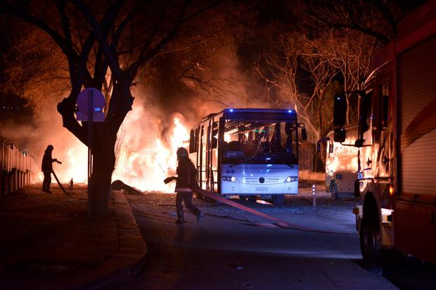 Firefighters try to extinguish flames following an explosion after an attack targeted a convoy of military service vehicles in Ankara on February 17, 2016. / AFP / STRINGERSTRINGER/AFP/Getty Images