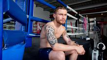 Family man: Carl Frampton, currently training in London, admits it's a struggle being away from wife Christine and kids Carla and Rossa
