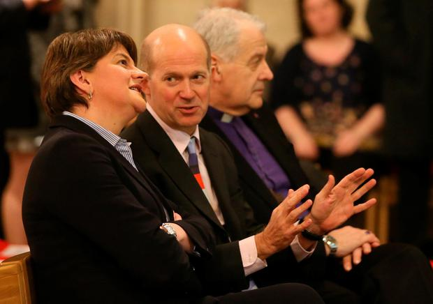 Northern First Minister and DUP leader Arlene Foster chats with British Ambassador Dominick Chilcott as they attend an event to mark the 1916 Rising at Christ Church Cathedral in Dublin. PA