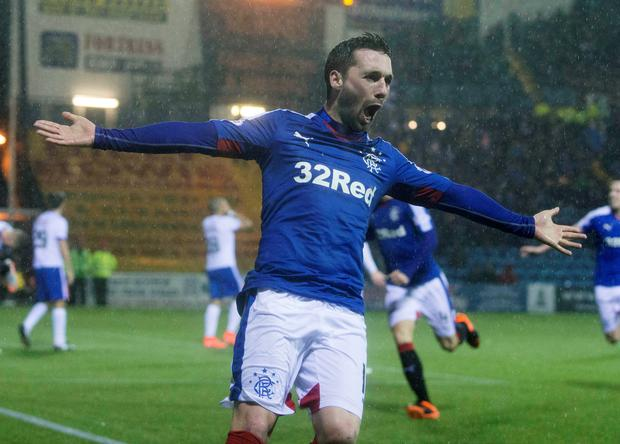 Pick it out: Nicky Clark celebrates Rangers' winner at Rugby Park