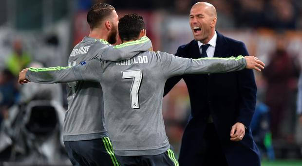 Perfect start: Cristiano Ronaldo celebrates his goal with Sergio Ramos and Real Madrid boss Zinedine Zidane