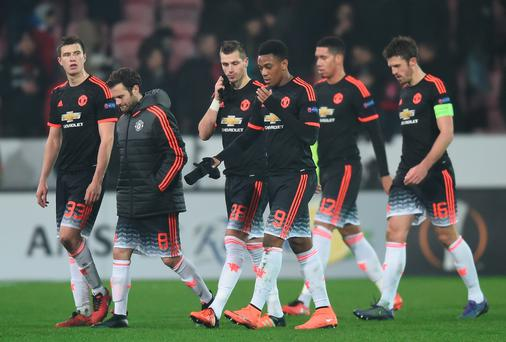 Manchester United players show their dejection after their 1-2 defeat in the UEFA Europa League round of 32 first leg match between FC Midtjylland and Manchester United at Herning MCH Multi Arena on February 18, 2016 in Herning, Denmark. (Photo by Michael Regan/Getty Images)