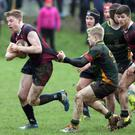 On the run: BRA's Michael McCracken tries to escape Down High's Lewis Finlay in the previous round of the Schools' Cup