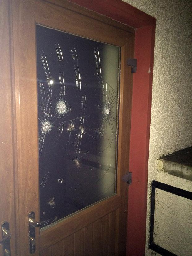 A door damaged in the first attack this week.
