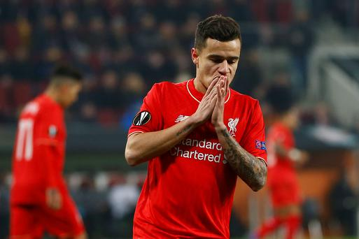 Liverpool's Philippe Coutinho reacts during the Europa League soccer match between FC Augsburg and FC Liverpool in Augsburg, southern Germany, Thursday, Feb. 18, 2016. (AP Photo/Matthias Schrader)
