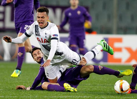 Thick of the battle: Tottenham's Dele Alli is brought down by Davide Astori of Fiorentina during their 1-1 draw in the Europa League in Italy
