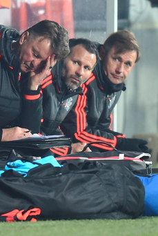 Same old story: United boss Louis van Gaal and assistant Ryan Giggs watch their side lose to Danish minnows FC Midtjylland