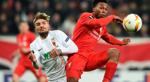 Eye on the ball: Liverpool's Daniel Sturridge battles with Augsburg defender Konstantinos Stafylidis