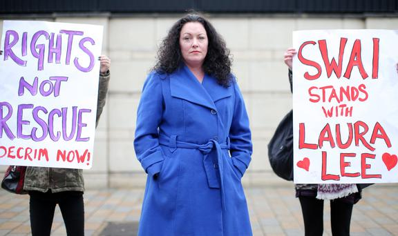 Sex worker and sex worker rights activist Laura Lee starts her challenge at the High Court in Belfast. Left to right are Kate McGrew, coordinator for Sex Workers Alliance of Ireland, Laura Lee and Dearbhla Ryan, Community Worker with Sex Workers Alliance of Ireland pictured outside the court. Picture by Jonathan Porter/PressEye