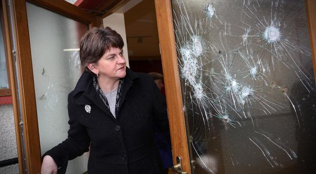 First Minister Arlene Foster surveys the damage at Strawletterdallon Orange hall, near Newtownstewart in Co Tyrone. Picture by Lorcan Doherty / Press Eye.