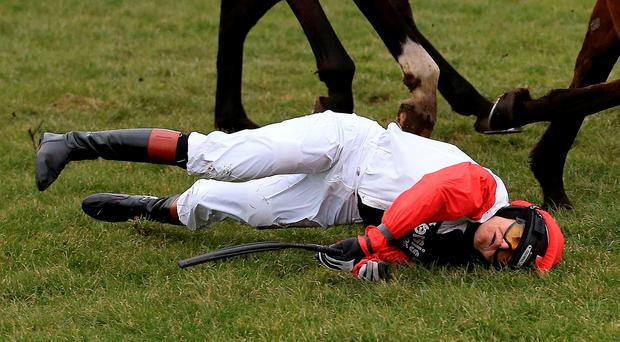 Victoria Pendleton after being unseated from Pacha Du Polder during the Betfair Switching Saddles 'Grassroots' Fox Hunters' Chase at Fakenham Racecourse. Nigel French/PA Wire