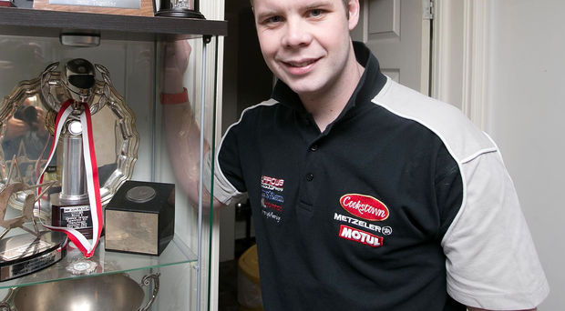 Grateful: beneficiary Jamie Hamilton with his racing trophy collection