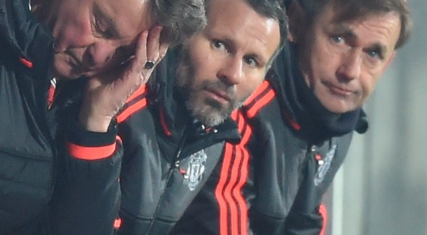 Testing times: Louis van Gaal and assistant manager Ryan Giggs look on as FC Midtjylland stun United in the Europa League