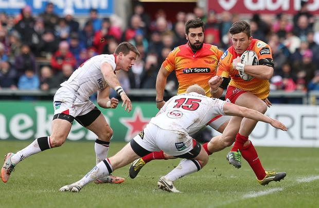 Ulsters Stuart Olding in action with Scarlets DTH van der Merwe.