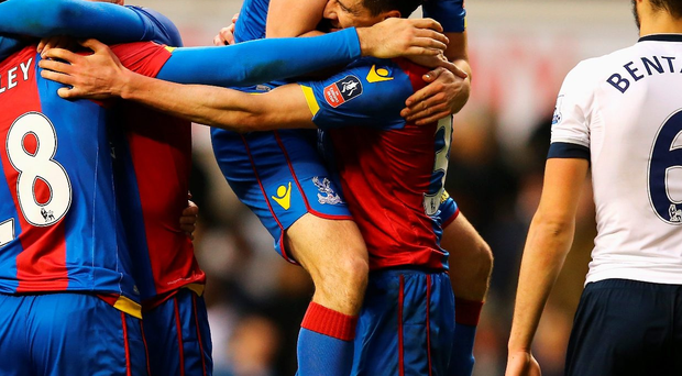 Get in: goal scorer Martin Kelly celebrates with Scott Dann
