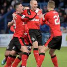 Bench mark: substitute Kenny Miller celebrates with his team mates after striking the winner