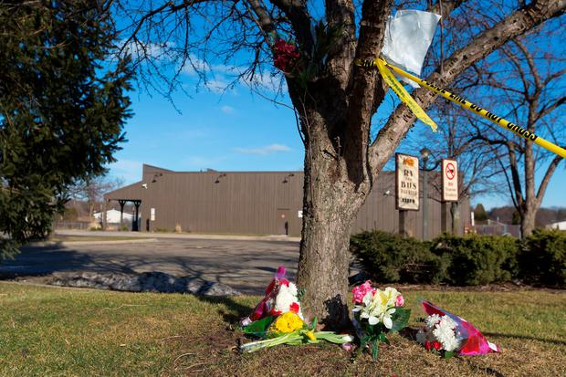 Flowers lie near a makes shift memorial outside a Cracker Barrel in Kalamazoo