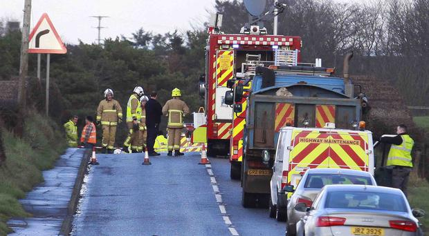 Fire crews at the scene of a gas leak on the Ballyrashane Road outside Coleraine. they operated an exclusion zone and several roads were closed and diversions in place. PICTURE MARK JAMIESON.