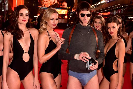 Sacha Baron Cohen in character as 'Nobby' (second from right) attending The World Premiere of Grimsby, at the Odeon Leicester Square, London. Dominic Lipinski/PA Wire