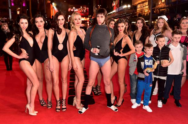 Sacha Baron Cohen in character as 'Nobby' (centre) attending The World Premiere of Grimsby, at the Odeon Leicester Square, London. Dominic Lipinski/PA Wire