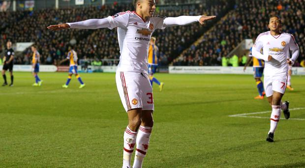 Manchester United's Jesse Lingard celebrates scoring his side's third goal of the game during the Emirates FA Cup, fifth round match at New Meadow, Shrewsbury. PRESS ASSOCIATION Photo.