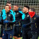 Relaxed mood: Mathieu Flamini, Alex Oxlade-Chamberlain and Mesut Ozil prepare for Arsenal's clash against Barcelona