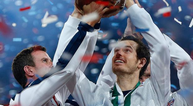 Glittering prize: Andy Murray lifts the Davis Cup with Great Britain captain Leon Smith