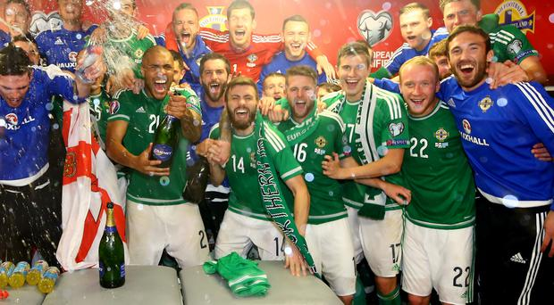 Reason to celebrate: Northern Ireland stars are set for a bonus after qualifying for Euro 2016