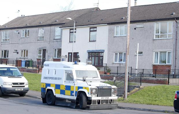 Police remain at the scene on Aspen Walk area of Dunmurry after last nights armed raid where two men were arrested. Picture by Jonathan Porter/PressEye