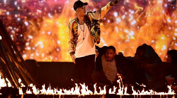 Justin Bieber performs on stage during the 2016 Brit Awards at the O2 Arena, London. Dominic Lipinski/PA Wire