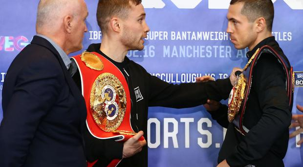 Let's get it on: Carl Frampton gets to grips with rival Scott Quigg yesterday and can't wait to do it for real tomorrow