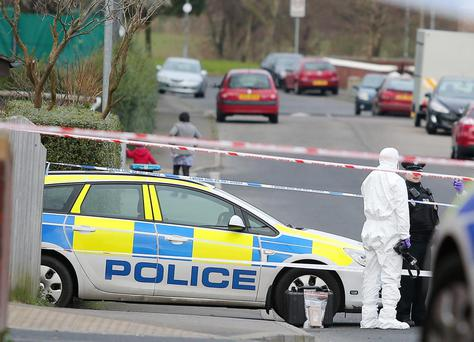 Police at the scene on Haywood Avenue round the corner from Walmer Street where a 28-year-old man was shot last night and who later died in hospital. Picture by Jonathan Porter/PressEye