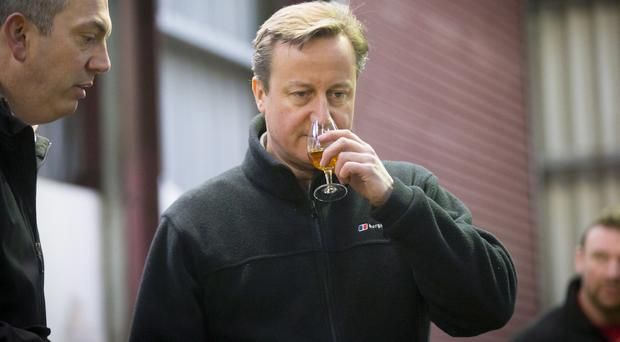 Prime Minster David Cameron as visits the Old Bushmills Distillery on February 27, 2016, Northern Ireland (Photo by Kevin Scott / Presseye)
