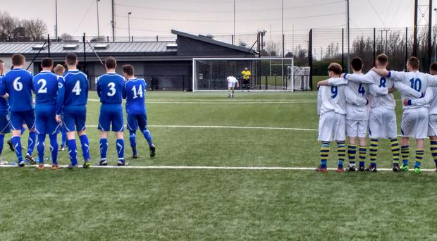 Players from Bangor Swifts (white) and Mossley line up to watch their Clarence Cup fate decided in a penalty shootout