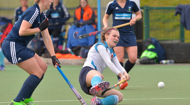 Taking aim: Ulster Elks' Jessica McMaster goes to ground while shooting for goal