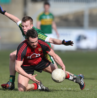 Tough task: Down's Mark Poland in action with Kerry's Fionn Fitzgerald