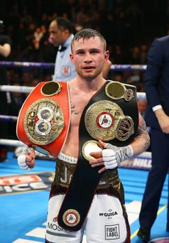 Carl Frampton celebrates after defeating Scott Quigg