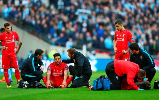 Down and out: Liverpool players are dejected after their loss to Man City