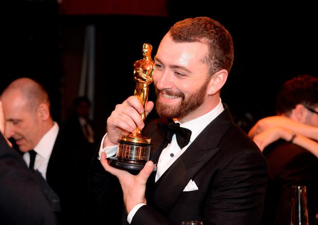 Singer-songwriter Sam Smith, winner of the Best Original Song award for 'Writing's on the Wall' from 'Spectre,' poses at the 88th Annual Academy Awards Governors Ball at Hollywood & Highland Center in Hollywood, California, on February 28, 2016. / AFP / ANGELA WEISSANGELA WEISS/AFP/Getty Images