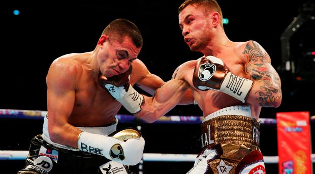Big hitter: Carl Frampton's uppercut breaks Scott Quigg's jaw
