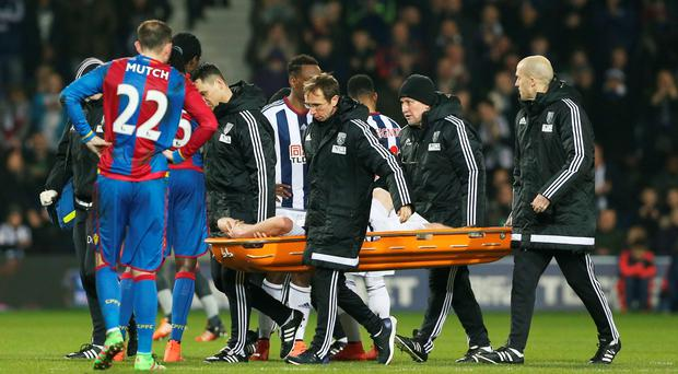 Worrying sight: West Brom ace Chris Brunt is stretchered off against Crystal Palace at the weekend