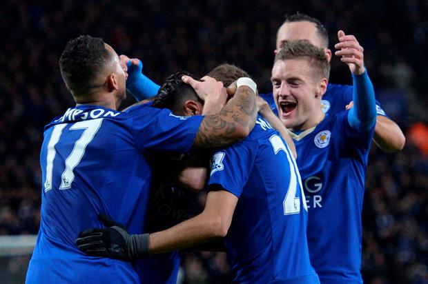 Leicester City's English striker Jamie Vardy (R) joins the celebration after Leicester City's Welsh midfielder Andy King scored their second goal during the English Premier League football match between Leicester City and West Bromwich Albion at the King Power Stadium in Leicester, central England on March 1, 2016. AFP/Getty Images