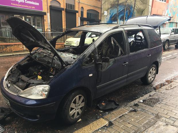 The burnt out car outside Aether and Echo on North Street in Belfast City Centre. Pic John Mulgrew